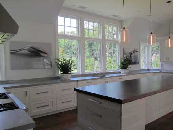 The kitchen at 4 Wee Burn Lane, Darien, CT $6.250M. As is the practice in Nantucket, they took a quaint old colonial, hollowed it out, and made an ultra-modern interior...