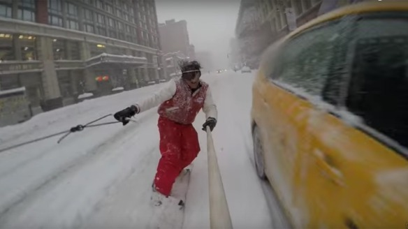 Some guy named Casey Neistat, snowboarding behind a Jeep, driven by his brother, through the streets of snow-covered Manhattan. Very cool!